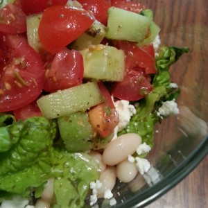 Greek Salad with navy beans, lettuce, feta, and tomato.