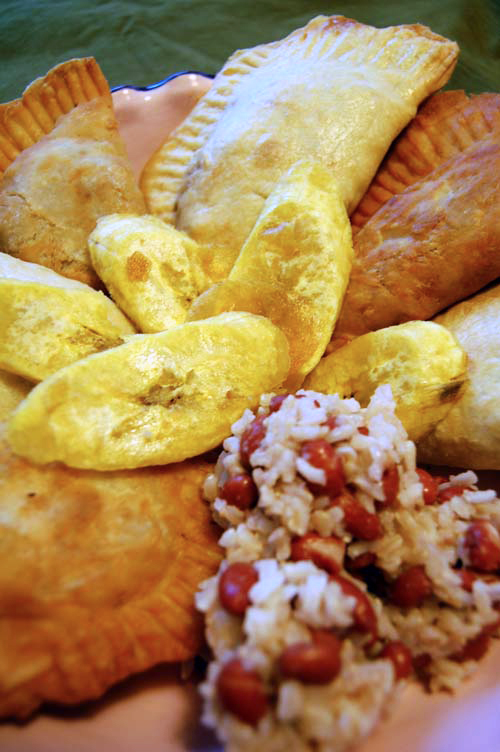 Empanadas, plantains, red beans and rice