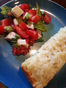 Cheesy Garlic Bread served with tomato salad